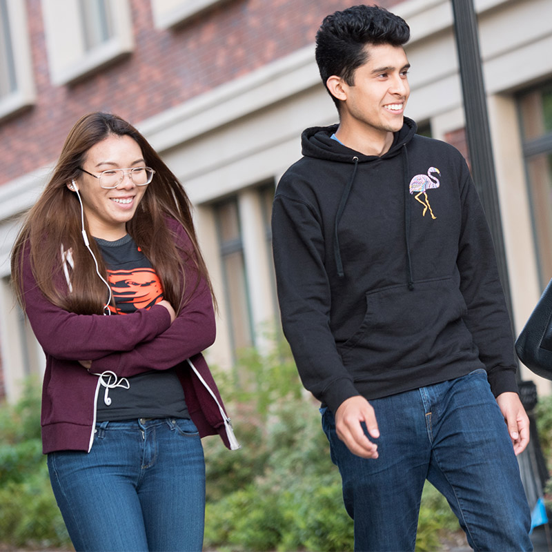 Two Oregon State students walk on the Corvallis campus.