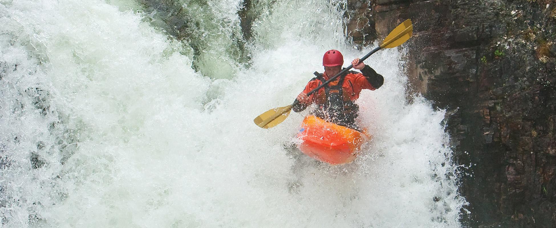 A kayaker navigates rapids.