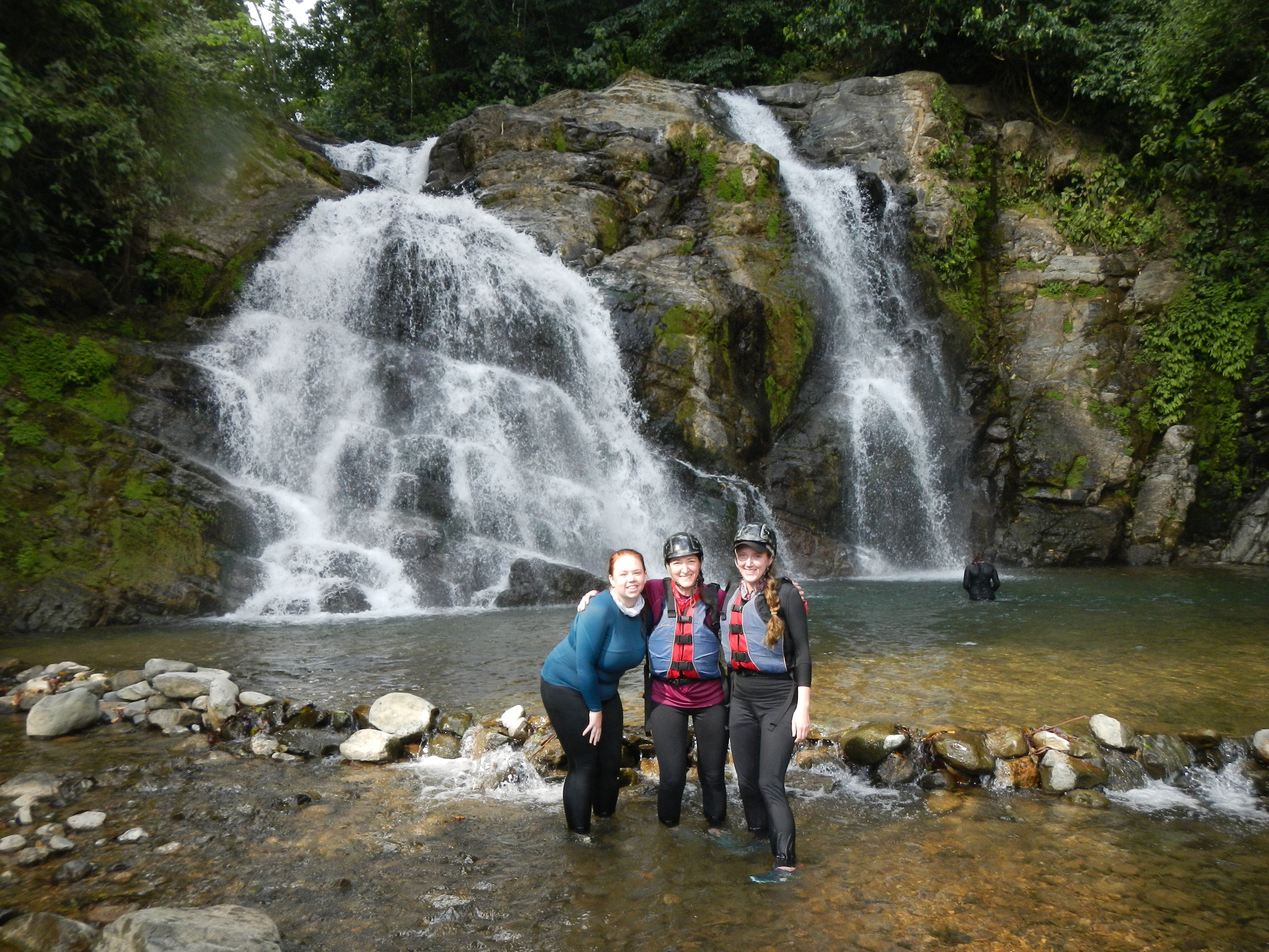 Students in front of a waterfall